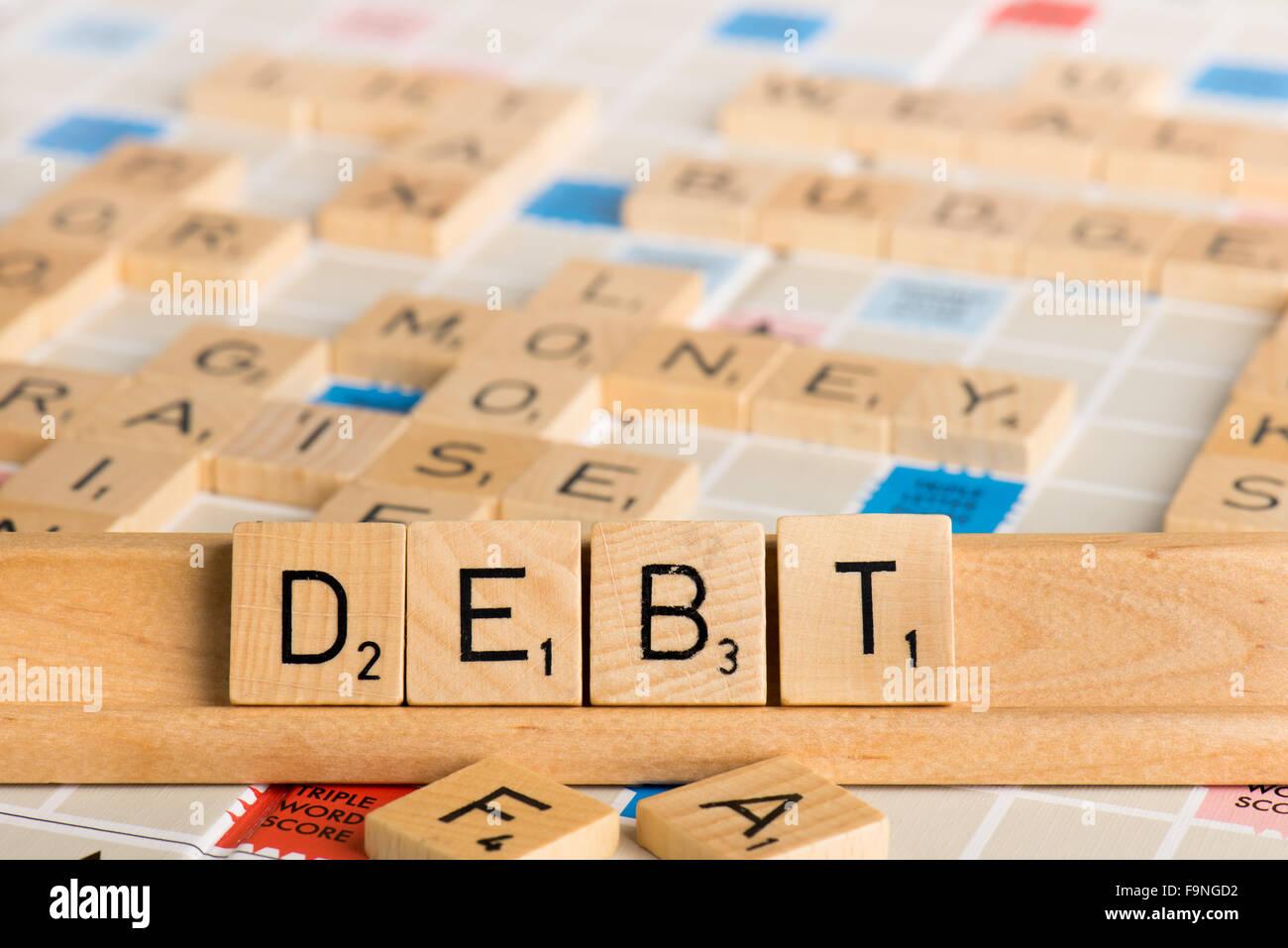 Scrabble - deuda Foto de stock