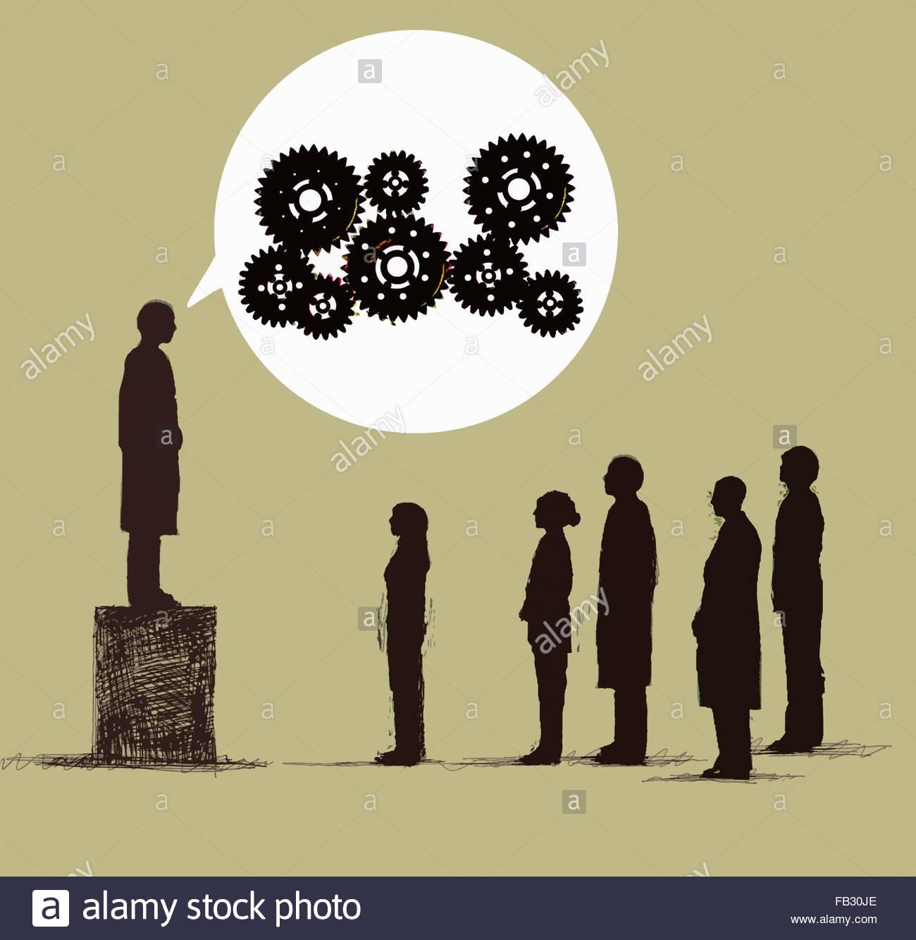 El hombre de la caja hablando a la audiencia con dientes en discurso de burbuja Imagen De Stock