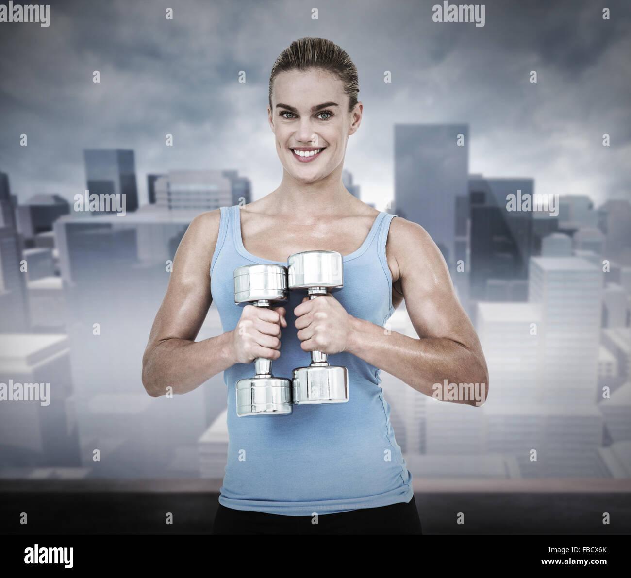 Imagen compuesta de mujer muscular el ejercicio con pesas Imagen De Stock