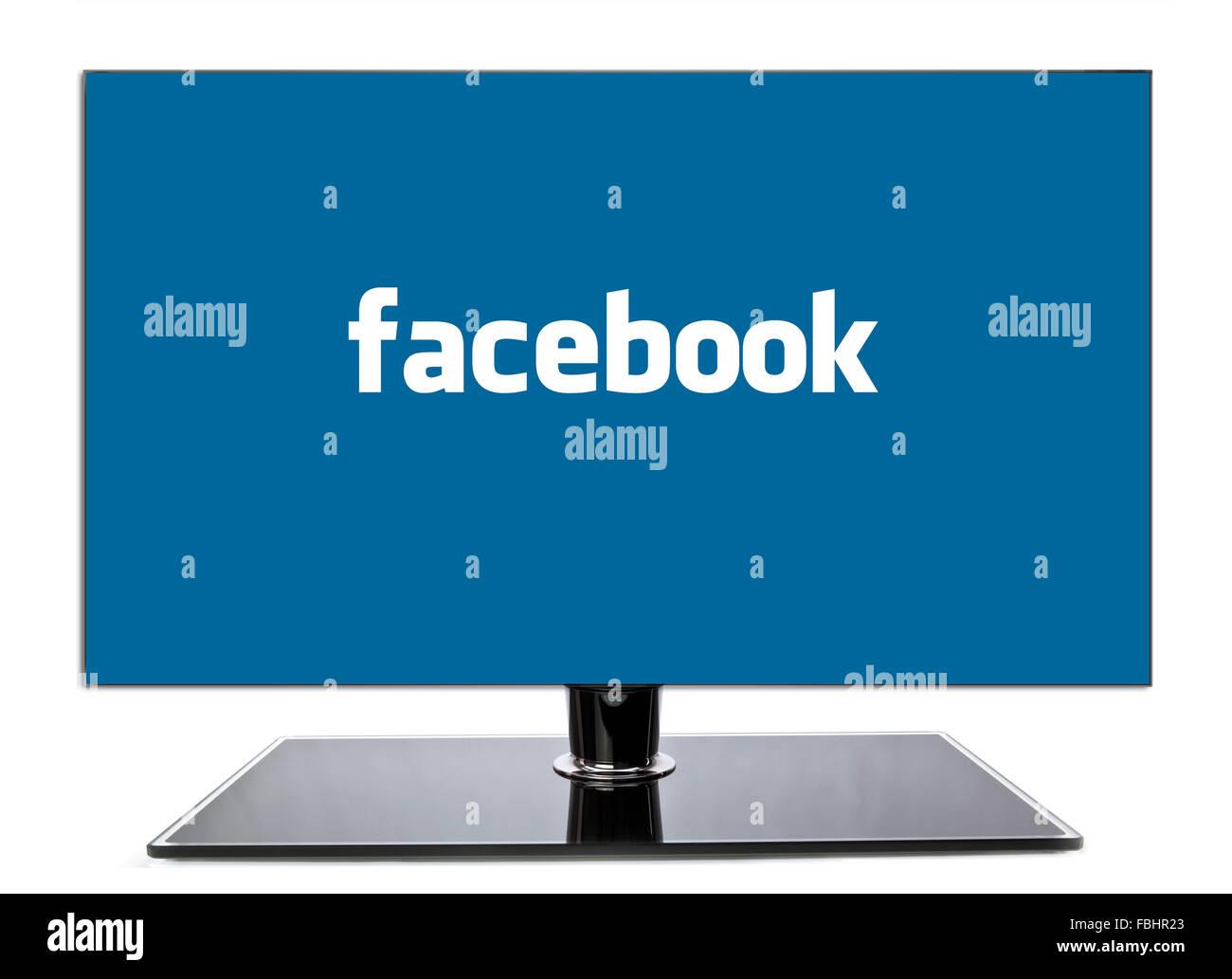 Monitor mostrando página en Facebook sobre un fondo blanco. Imagen De Stock