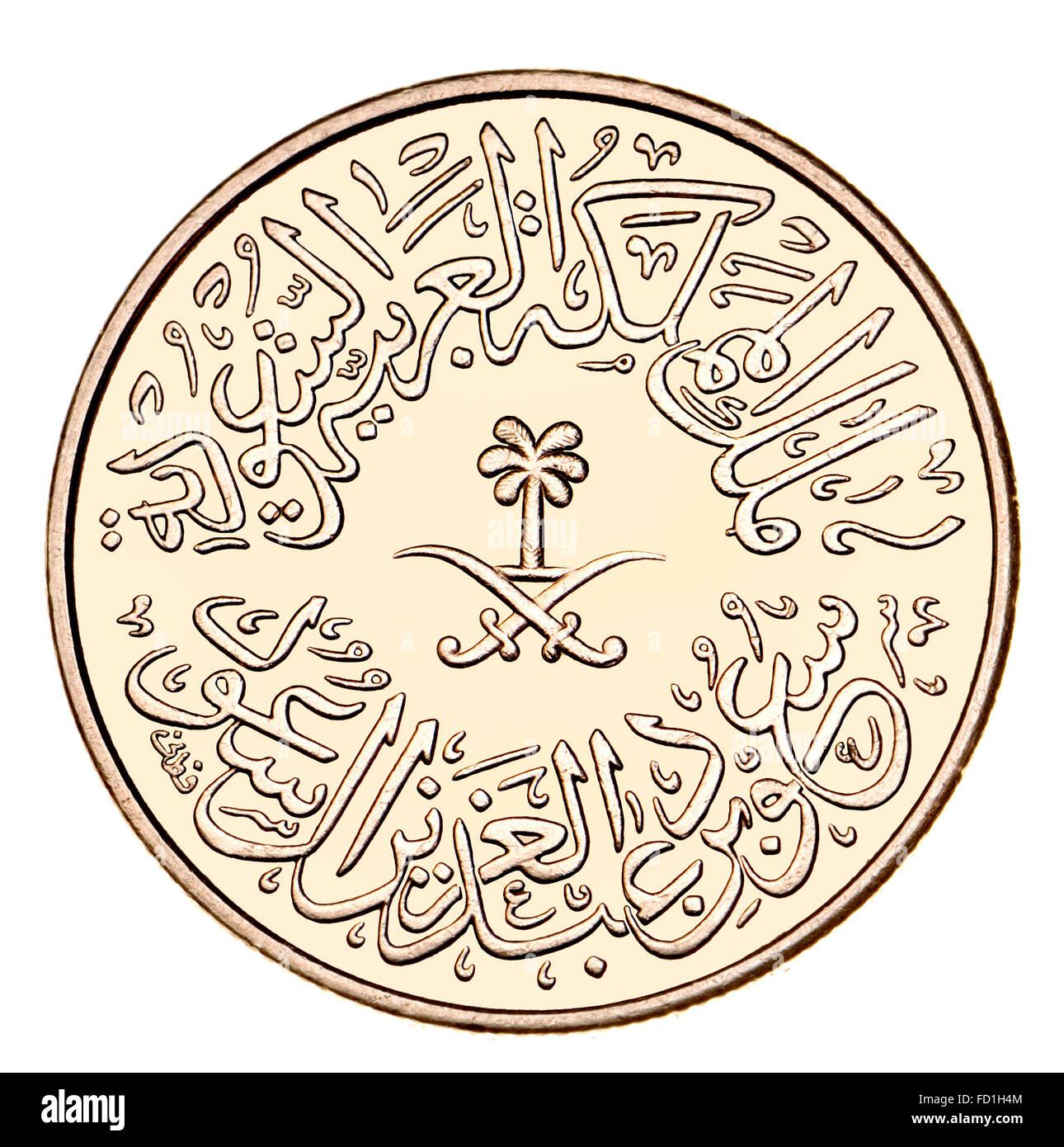 4 / Qirsh Ghirsh Coin de Arabia Saudita mostrando escritura árabe y símbolos, palmera y espadas cruzadas Imagen De Stock