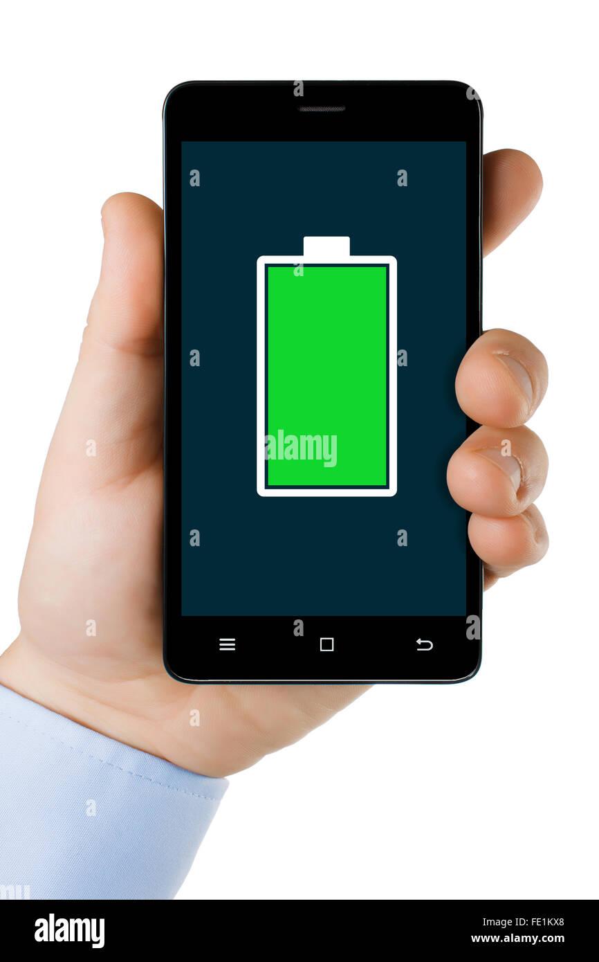 Mano sujetando el teléfono móvil con el icono de batería completa en la pantalla. Imagen De Stock