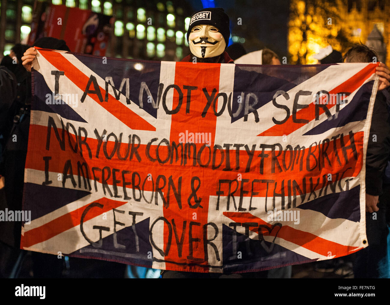 Manifestante enmascarado con banner, máscara de millones de marzo, Londres 2014 Imagen De Stock