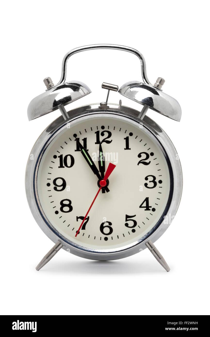 Antiguo reloj despertador de metal sobre fondo blanco. Imagen De Stock
