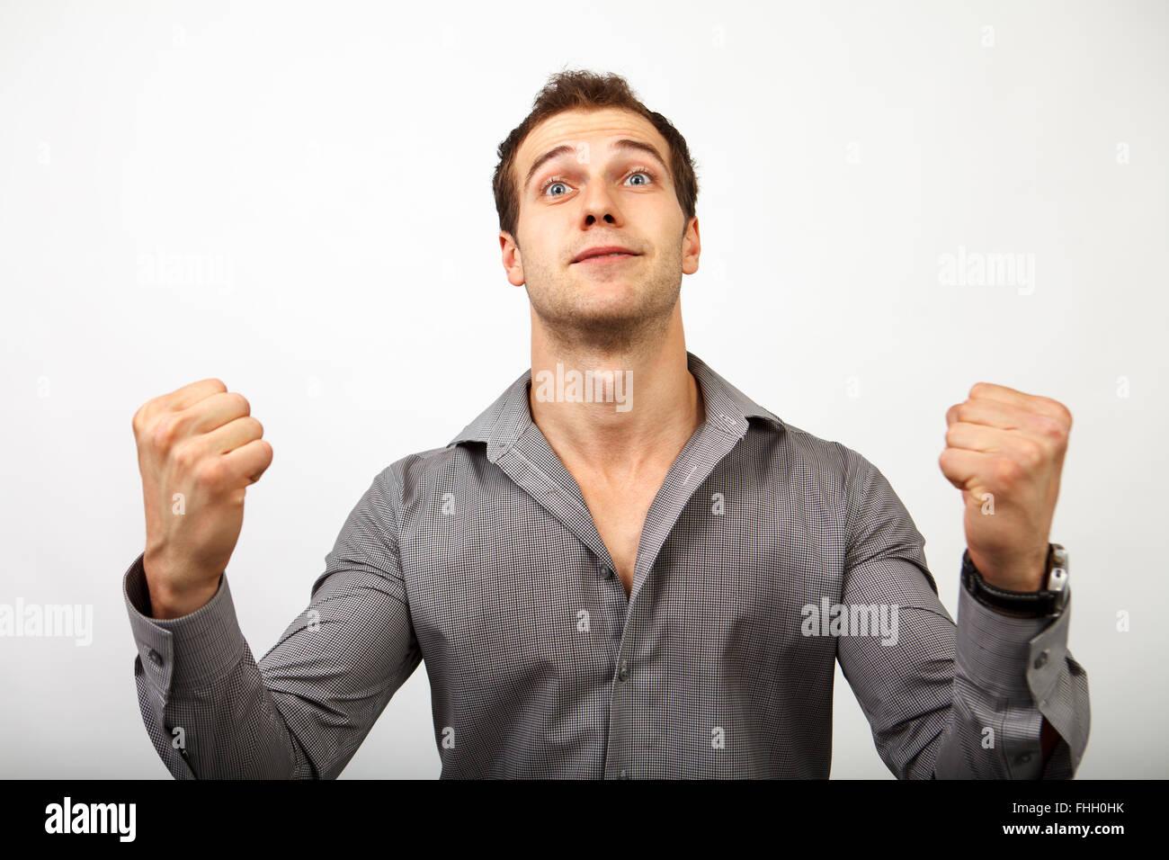 Feliz ganar hombre aislado sobre blanco Imagen De Stock