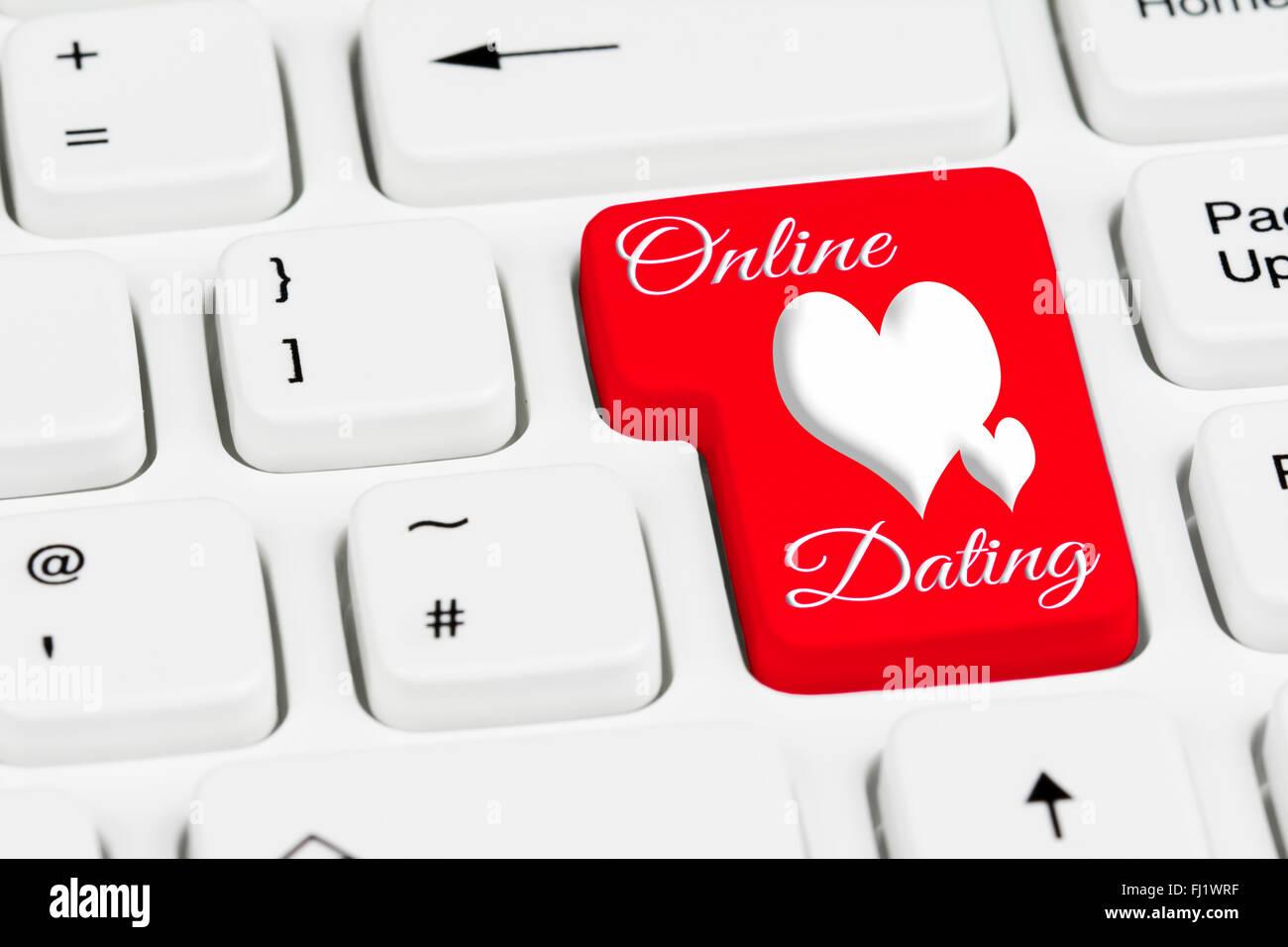 Online dating botón en blanco un teclado de ordenador. Imagen De Stock