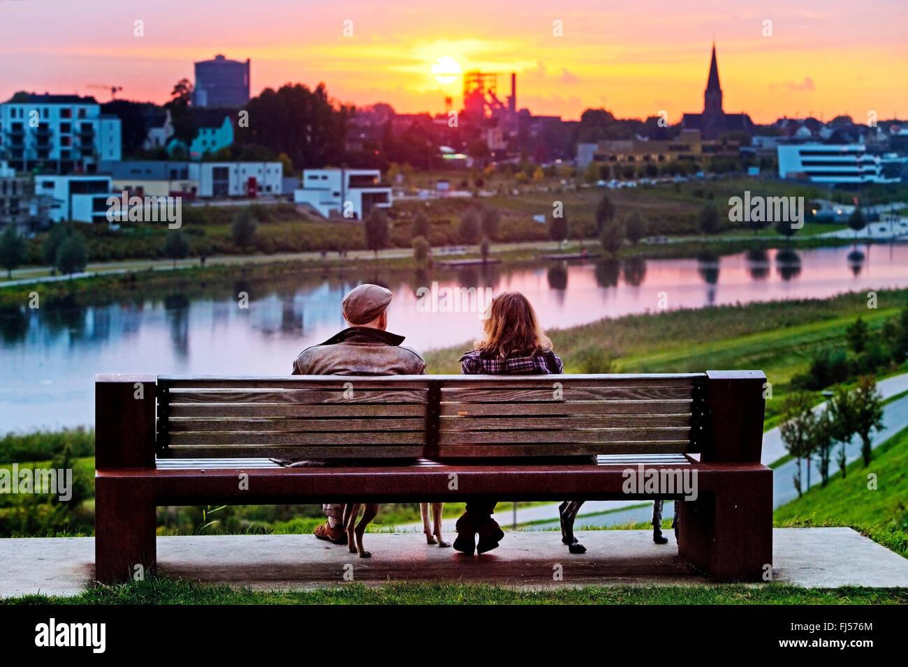 Man Sitting On Bench At Sunset Imágenes De Stock & Man
