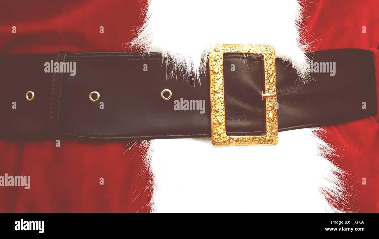 Parte media de persona en traje de Santa Claus Foto de stock