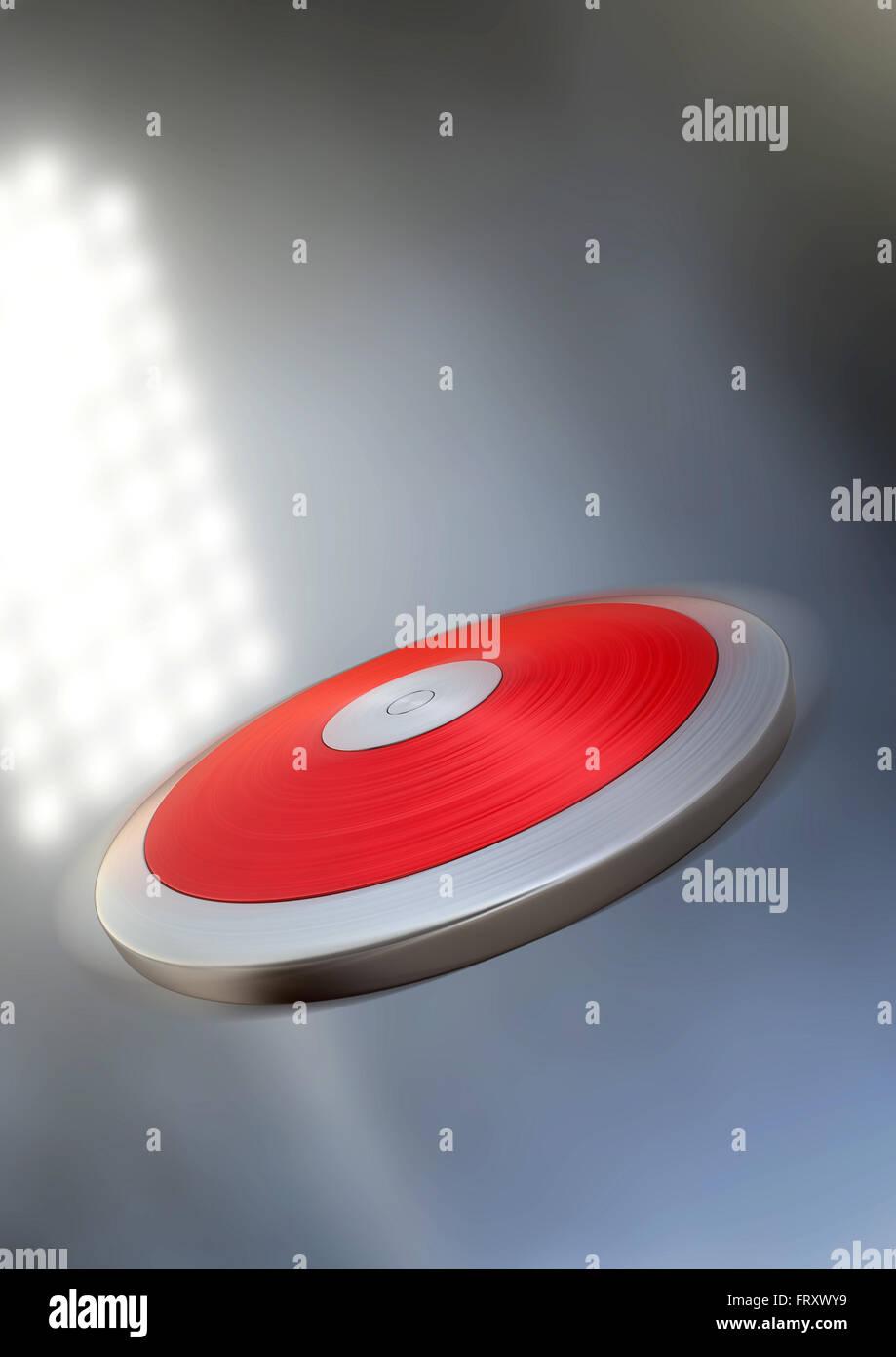 Un discus volando por el aire en un estadio genérico iluminado en la noche bajo los bañadores Foto de stock