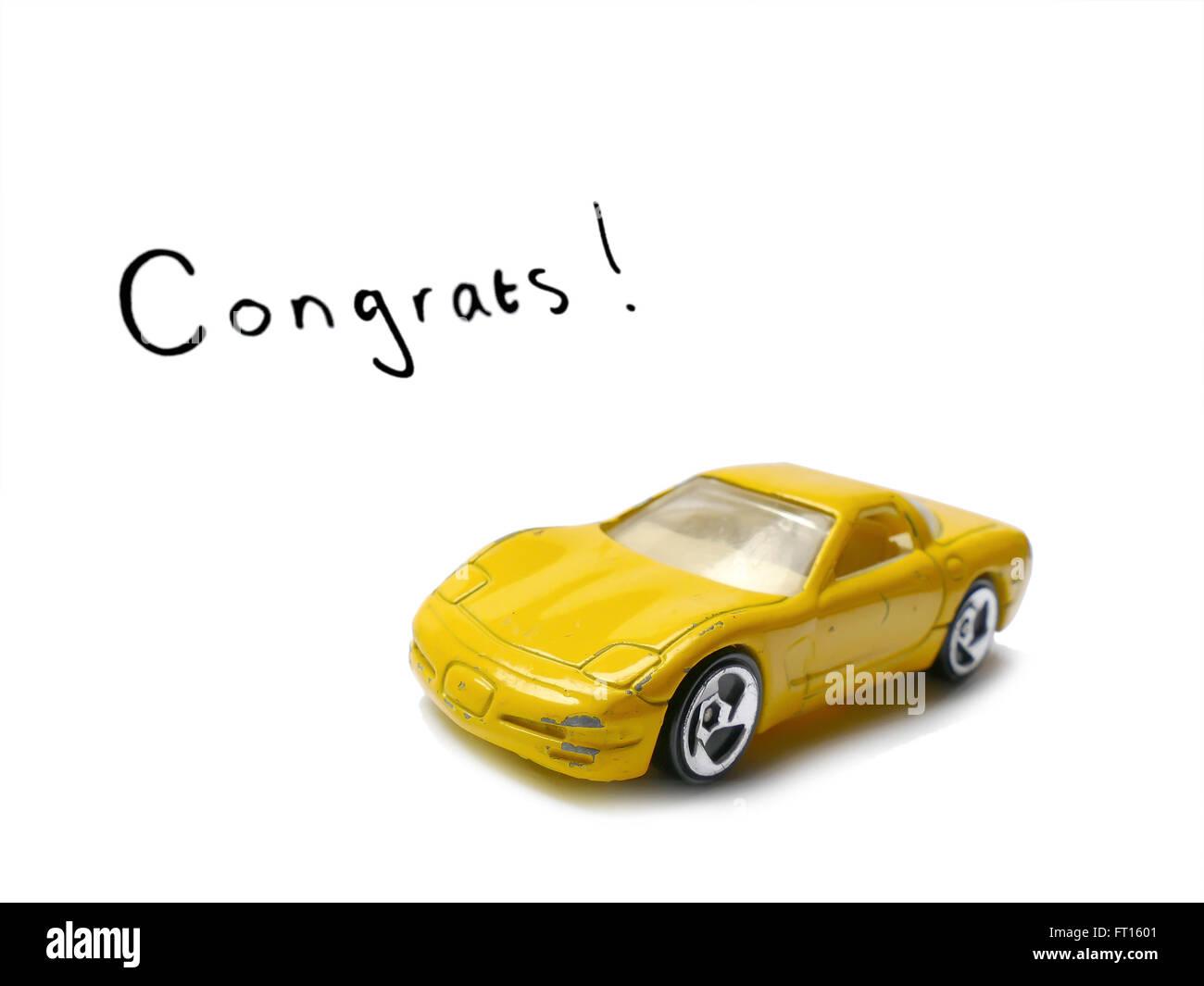 Felicitaciones la licencia de conductor con el viejo modelo de coche de juguete Imagen De Stock