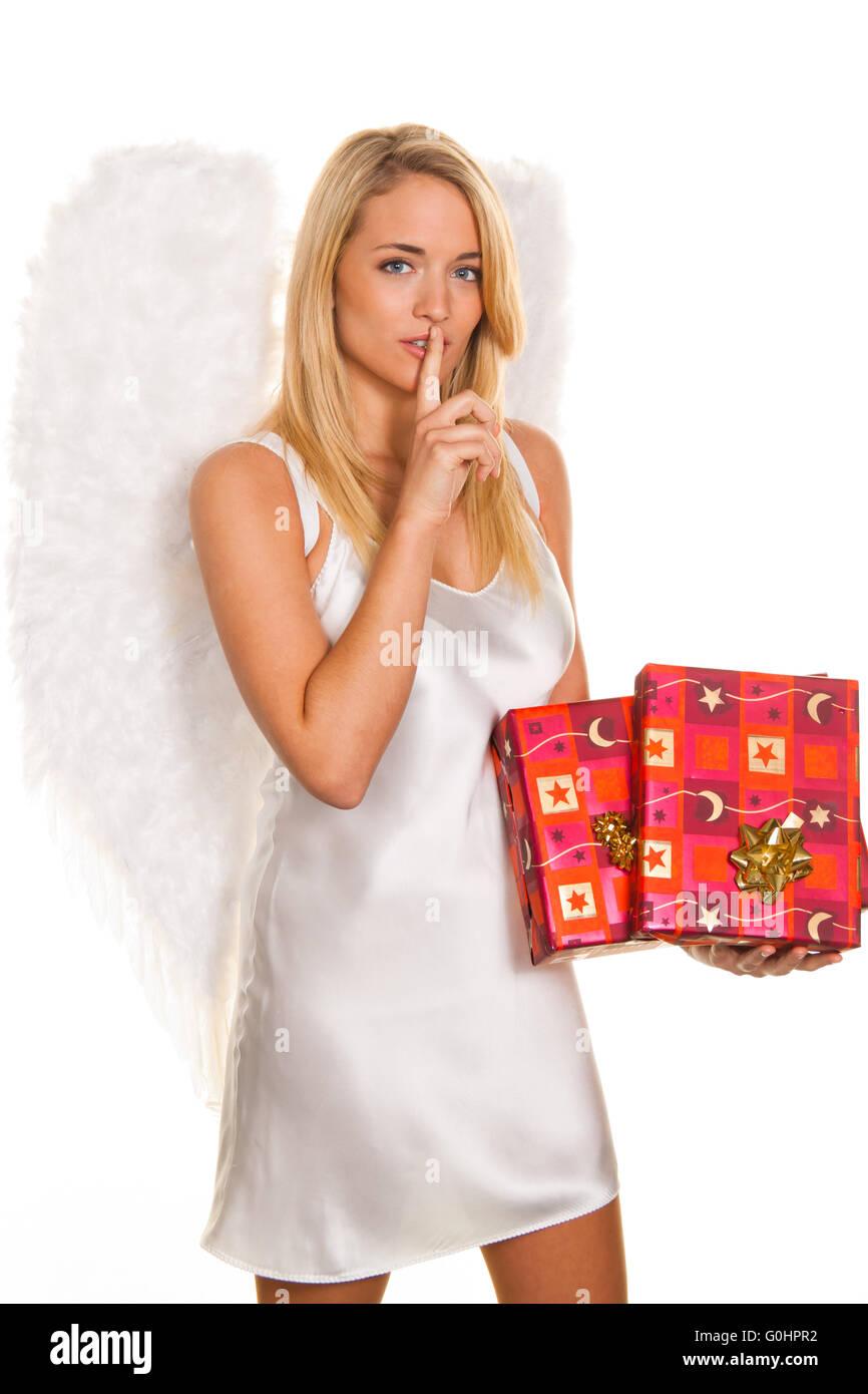 Ángeles de Navidad con paquetes y regalos. Foto de stock