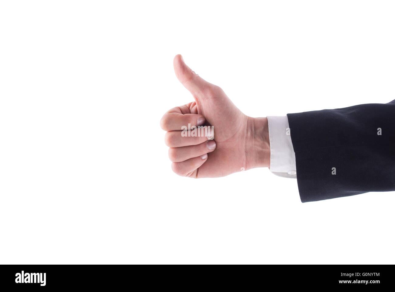 Hombre de mano en un traje dando un pulgar hacia arriba sobre fondo blanco. Imagen De Stock