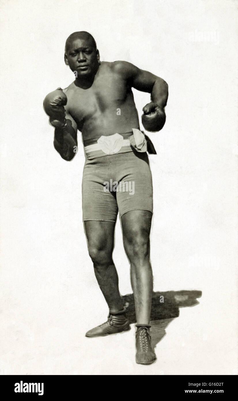 Wagner y postal de Caywood Johnson llevaba pantalones cortos de boxeo y guantes de boxeo, 1910. John Arthur 'Jack' Foto de stock