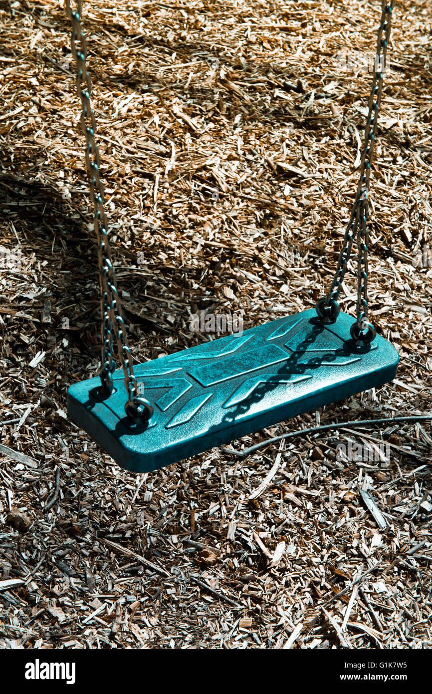 Swing en un campo de juego Imagen De Stock