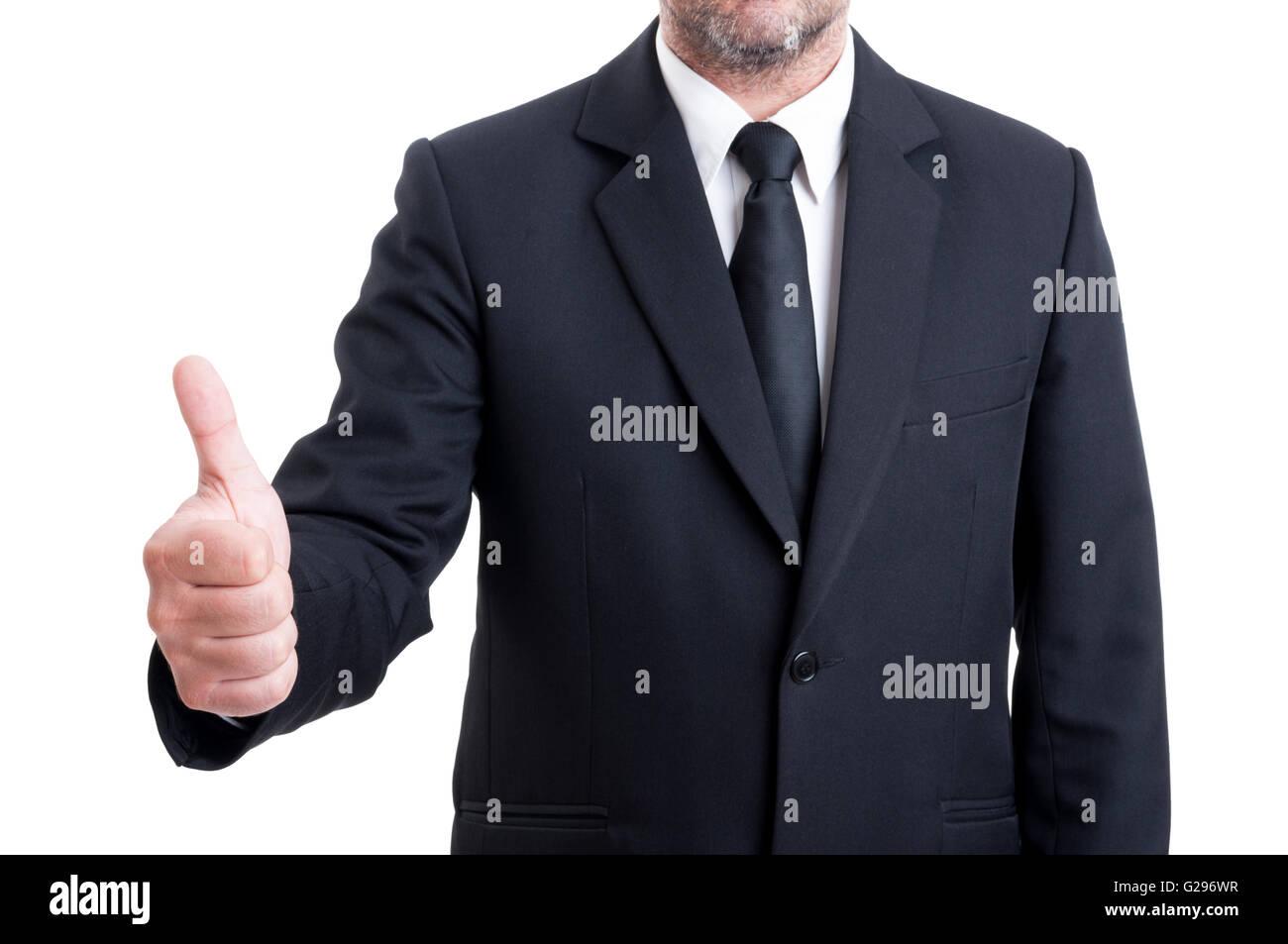 Anonymus hombre de negocios mostrando el pulgar hacia arriba o bien gesto aislado sobre fondo blanco. Imagen De Stock