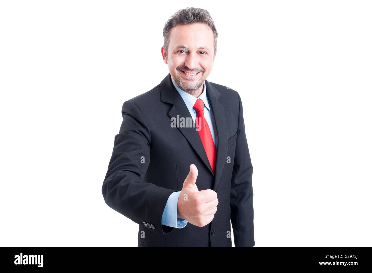 Hombre de ventas mostrando el pulgar vestidos de traje negro, camisa azul y corbata roja Imagen De Stock