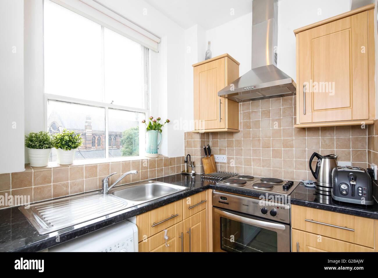 Park House, Harrington Road. Cocina moderna con gabinetes de madera ...