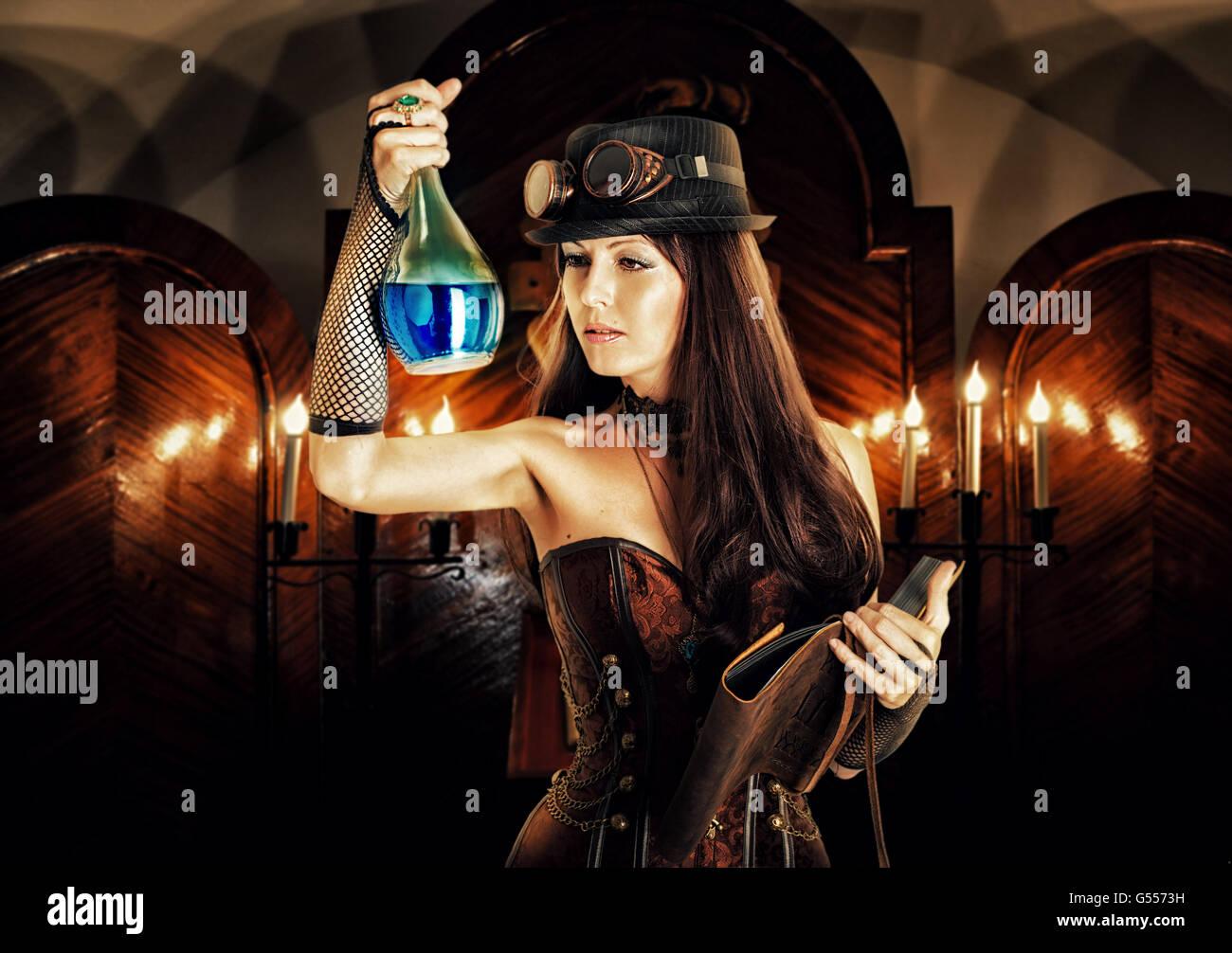 Alchemist. Hermosa mujer brunete vistiendo steampunk estilo bruja ...
