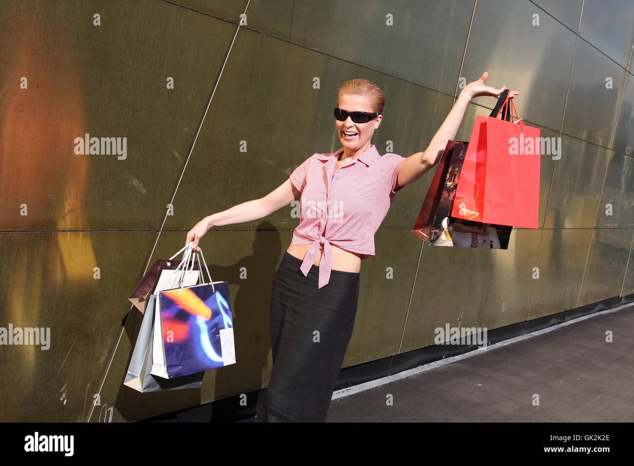 Compras Mujer comunicarse Imagen De Stock