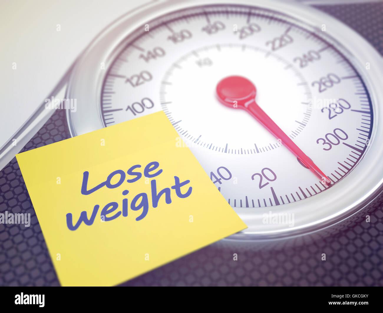 Báscula con recordatorio para perder peso. Profundidad de campo con enfoque en el recordatorio. Imagen De Stock