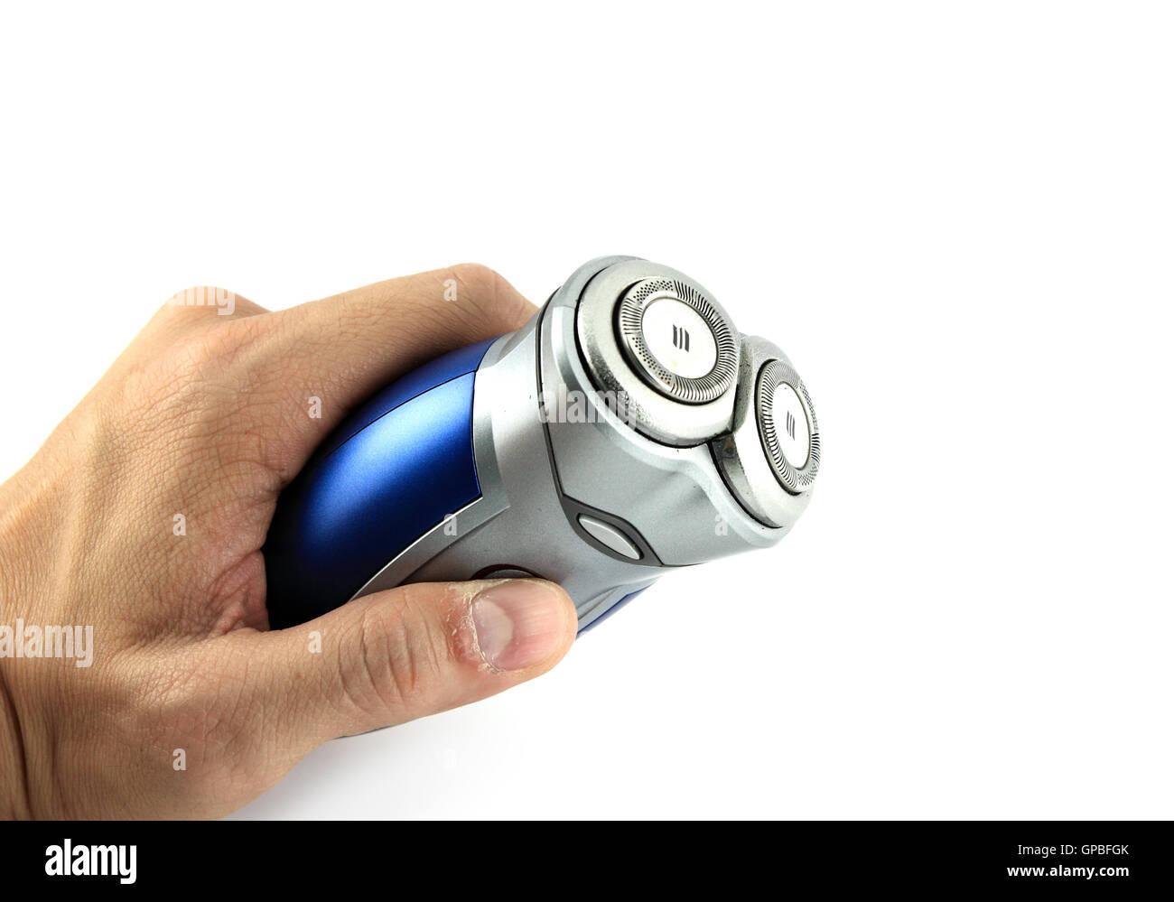 Afeitadora eléctrica sosteniendo en la mano aislada con fondo blanco.  Imagen De Stock 3336712d1366
