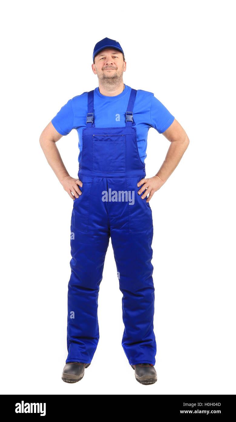 Trabajador en un mono azul. Imagen De Stock