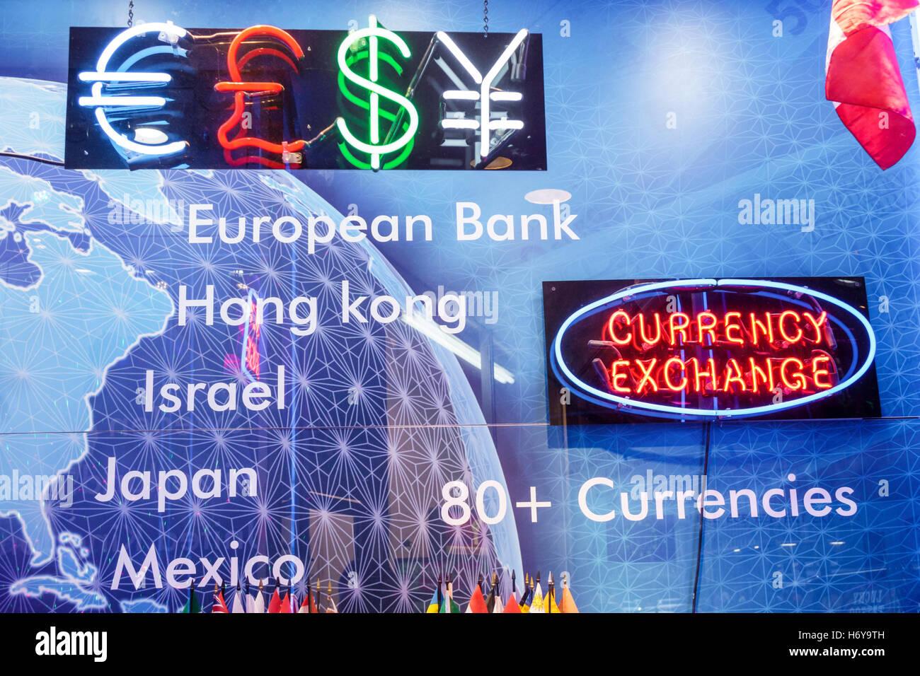 Florida, Sur, Miami Beach, cambio de divisas, símbolos monetarios, neón signo, visitas turísticas viajar viaje turismo Foto de stock