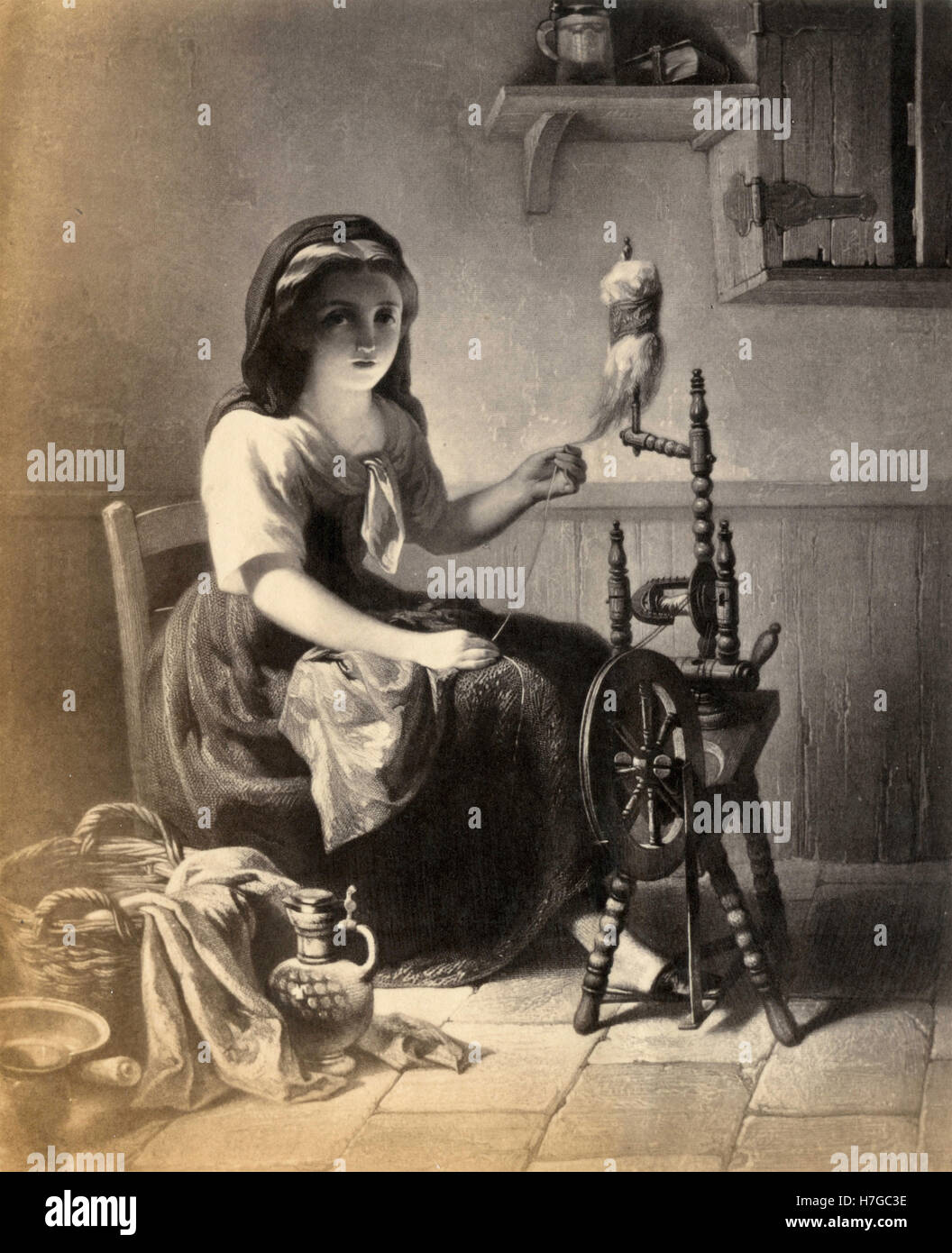 Mujer hilando lana, imprimir Foto de stock