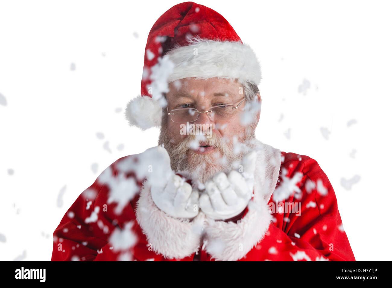 Santa Claus Holding Snow Blowing Imágenes De Stock   Santa Claus ... 505bd88f861