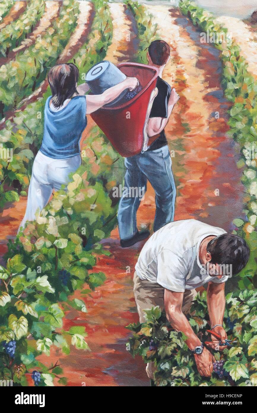 La pintura en la pared ilustrando la vendimia en Beaujolais, Francia Imagen De Stock
