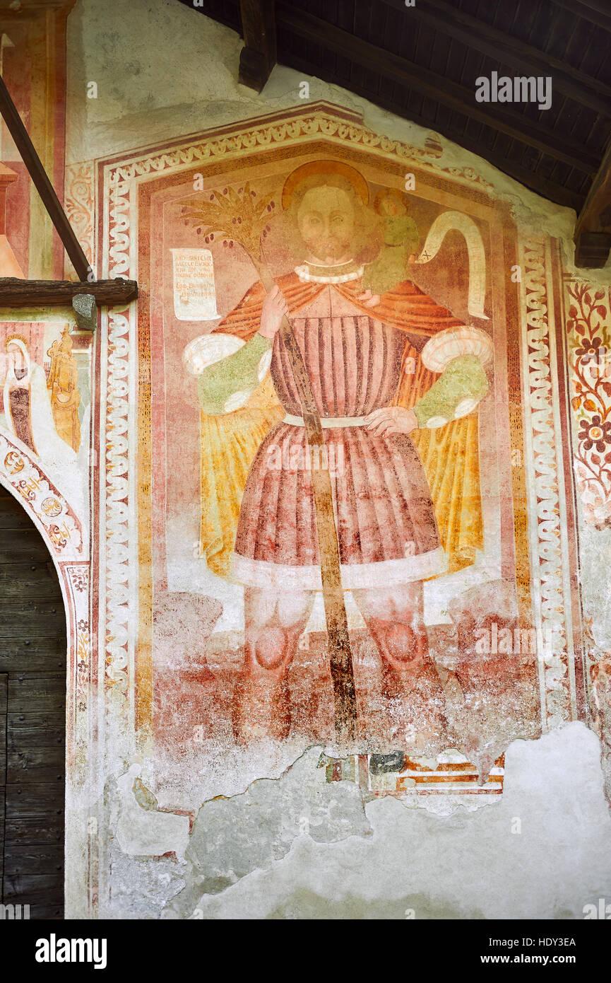 Mural religiosa de San Cristóbal con Cristo sobre sus hombros por Dionislo Baschenis, con fecha de 1493, en Imagen De Stock