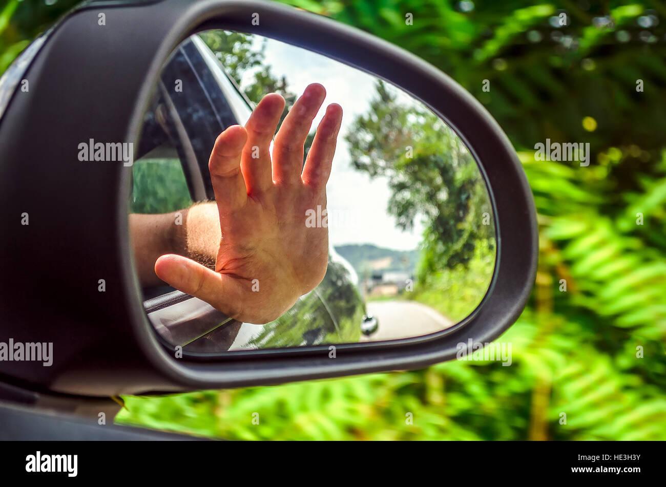 Espejo retrovisor mano car window Imagen De Stock