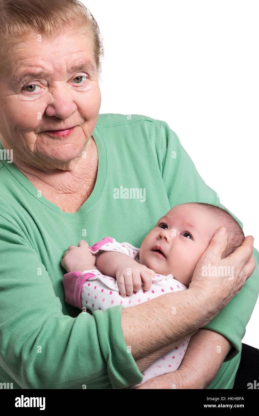 Abuela sosteniendo bebé recién nacido Imagen De Stock