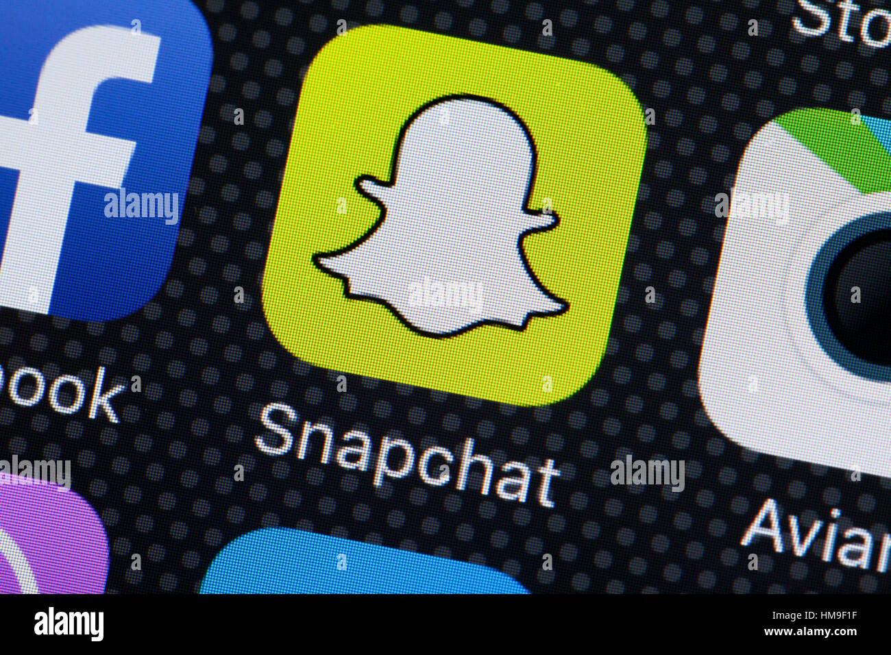 Snapchat app icono en pantalla móvil - EE.UU. Imagen De Stock