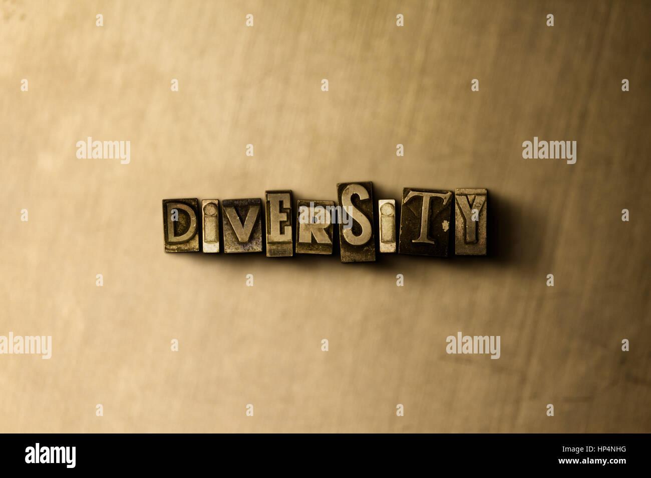 Diversidad - close-up de sucio vintage tipografía palabra sobre metal como telón de fondo. Royalty free ilustración. Foto de stock