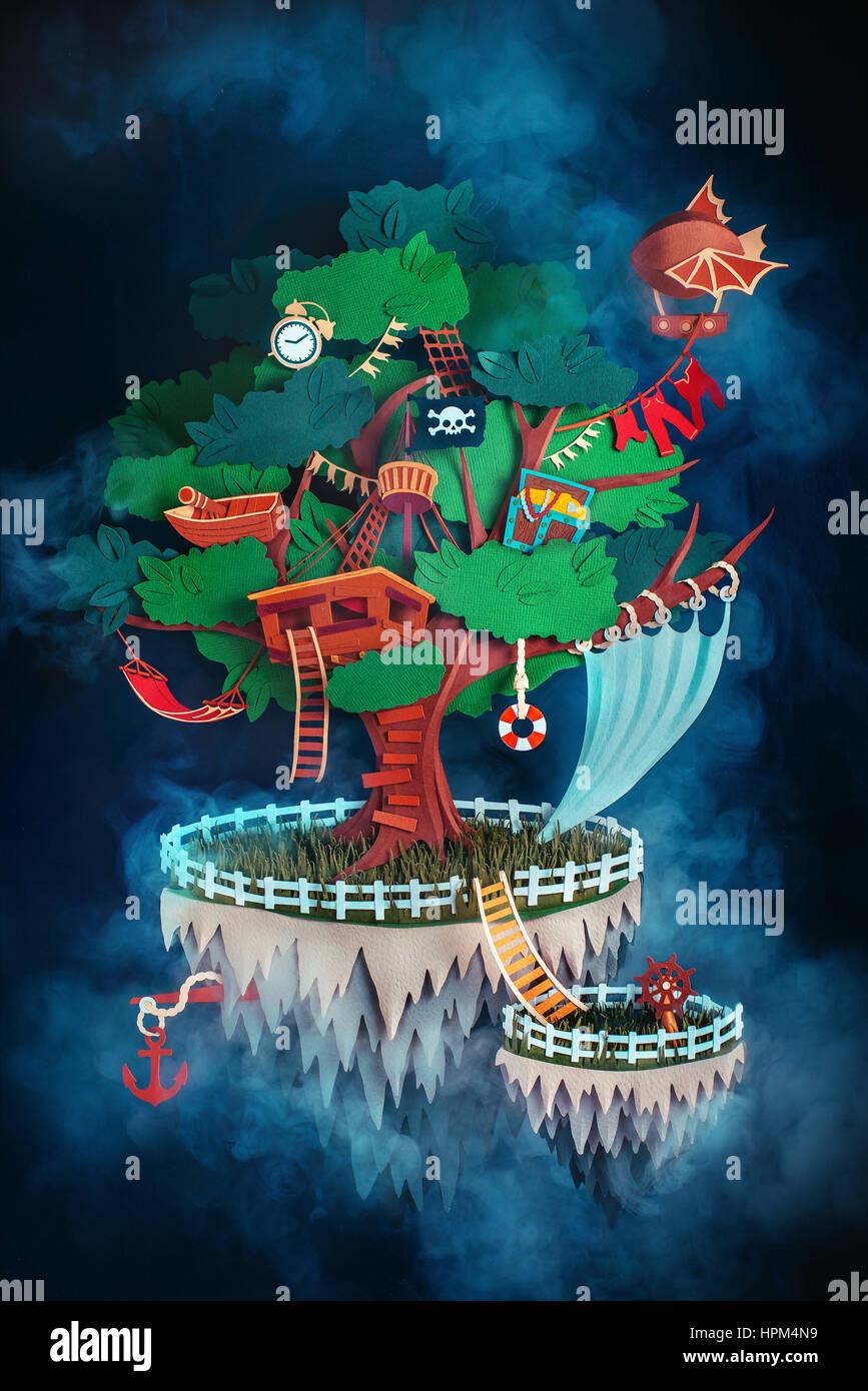 Isla flotante con una bandera pirata, treehouse, un dirigible y un cofre del tesoro de papel Imagen De Stock