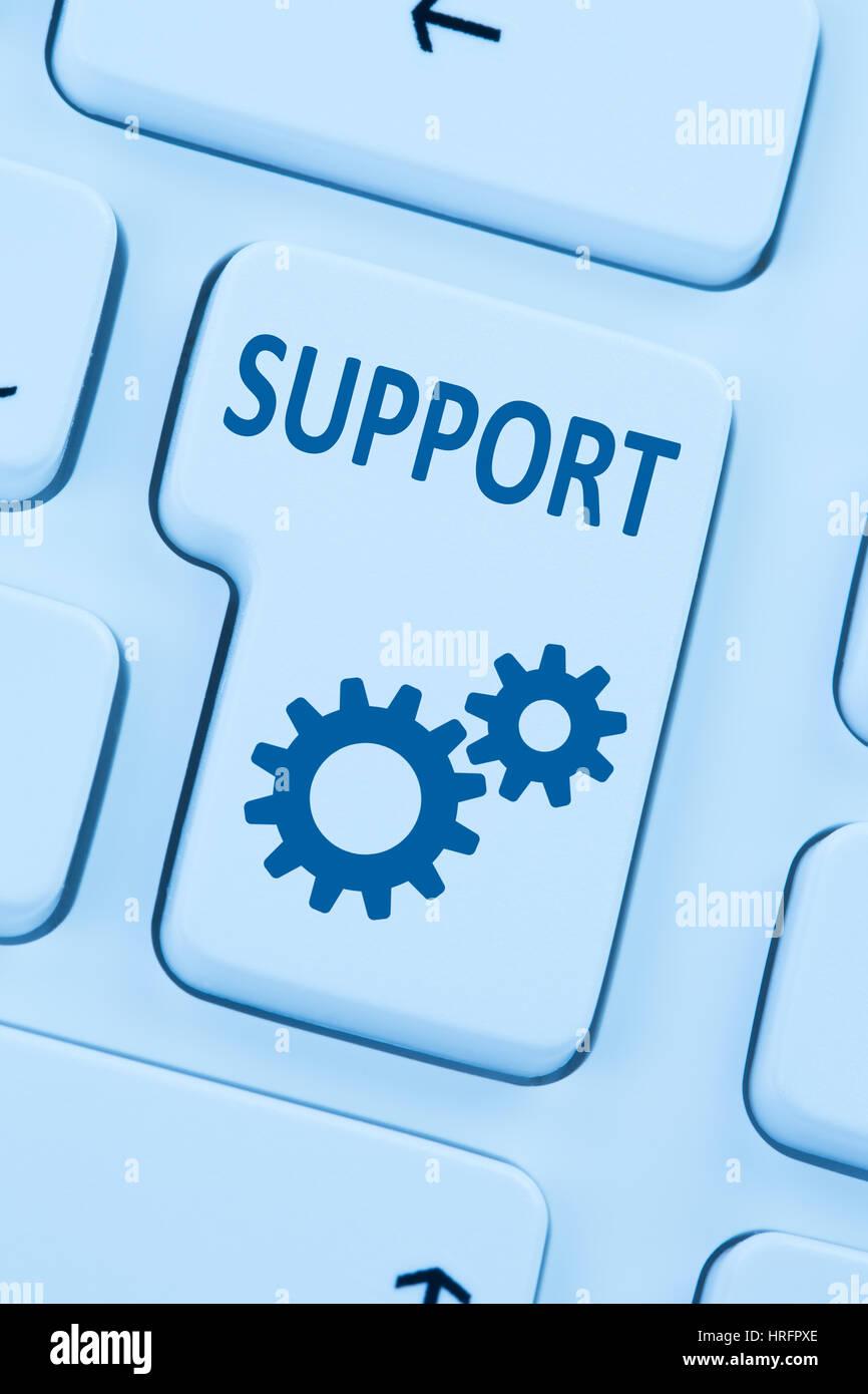 Soporte atención al cliente servicio de ayuda en línea en la internet equipo azul teclado web Foto de stock