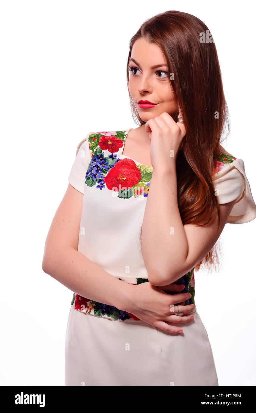 Retrato de alegre Ukrainian girl vistiendo camisa bordada nacional aislado  en blanco Imagen De Stock d9efb0b050c86