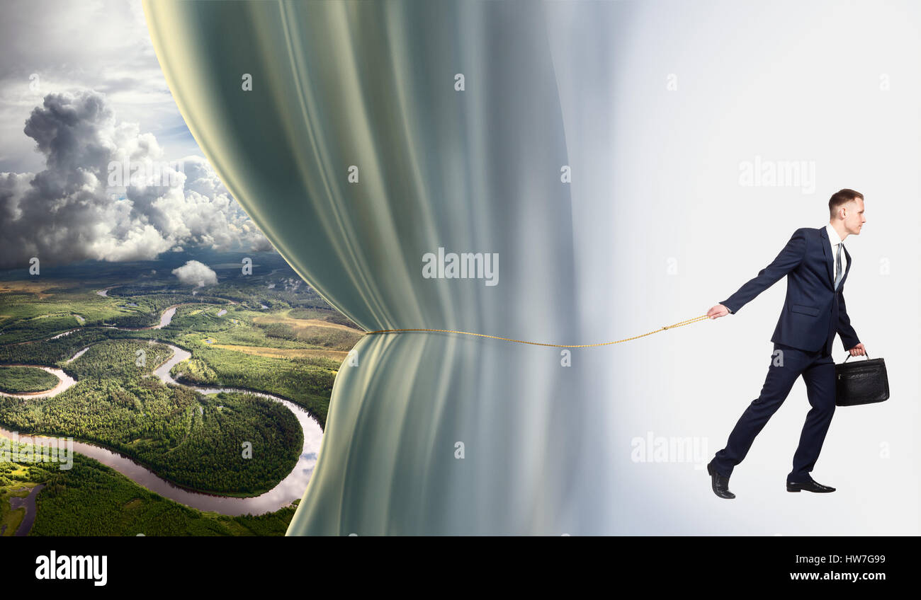 Joven empresario muestra la previsión meteorológica, idea conceptual Imagen De Stock