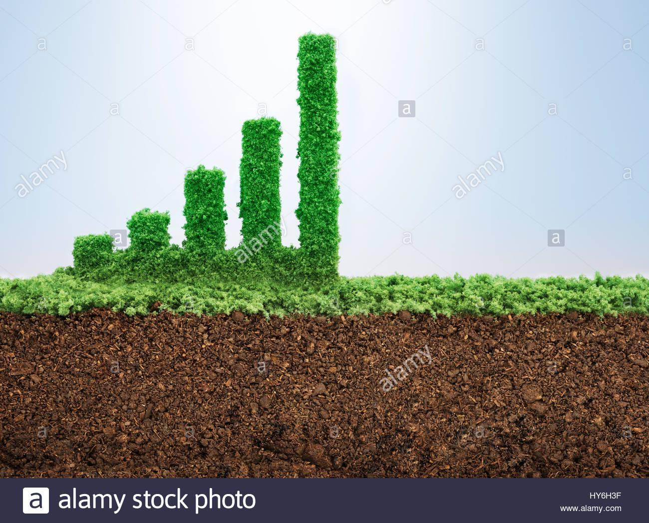 Concepto de crecimiento empresarial con césped que crece en forma de gráfico de barras Imagen De Stock