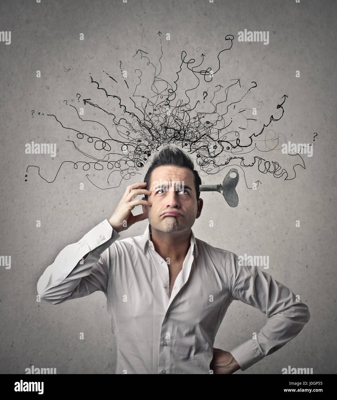 Empresario con un lío en la cabeza Imagen De Stock