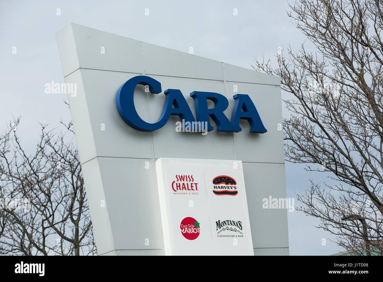Un logotipo firmar fuera de la sede de Cara Operations Ltd., en Vaughan, Ontario, Canadá, el 16 de abril de Imagen De Stock
