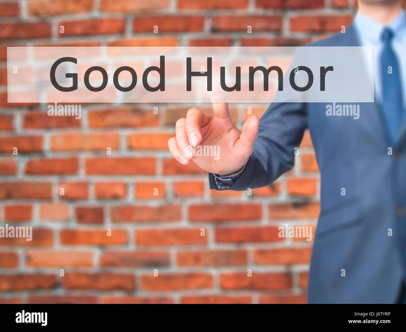 Buen Humor - Empresario mano pulsando el botón en la interfaz de pantalla táctil. Negocios, tecnología, Imagen De Stock