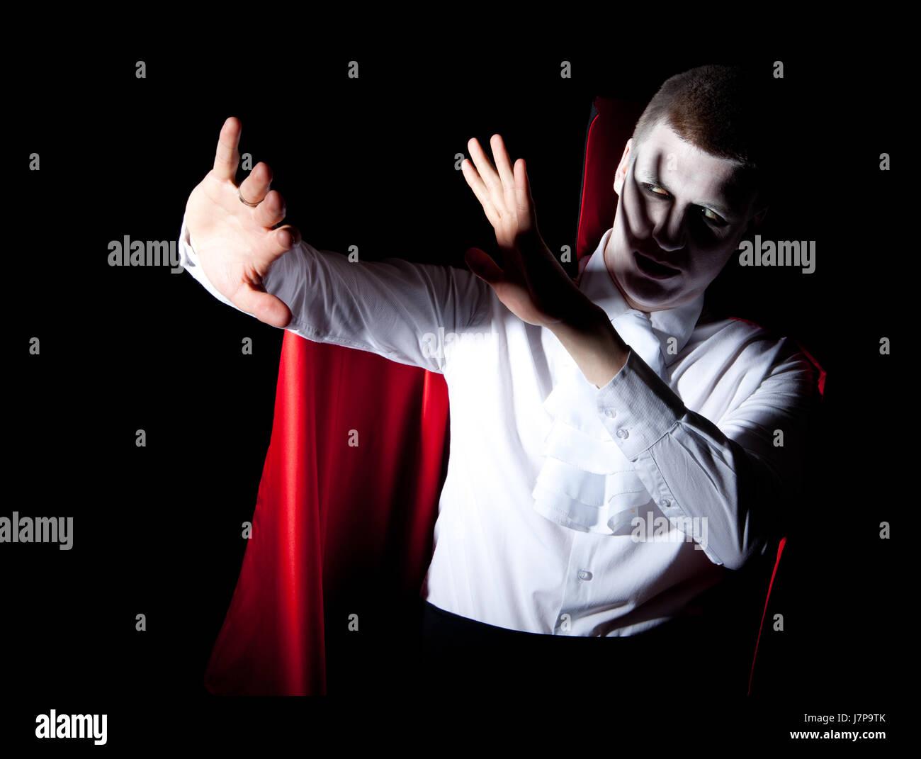 Peligro manos mano dolor proteger protección defensa shaddow vampiro luz sombra Foto de stock