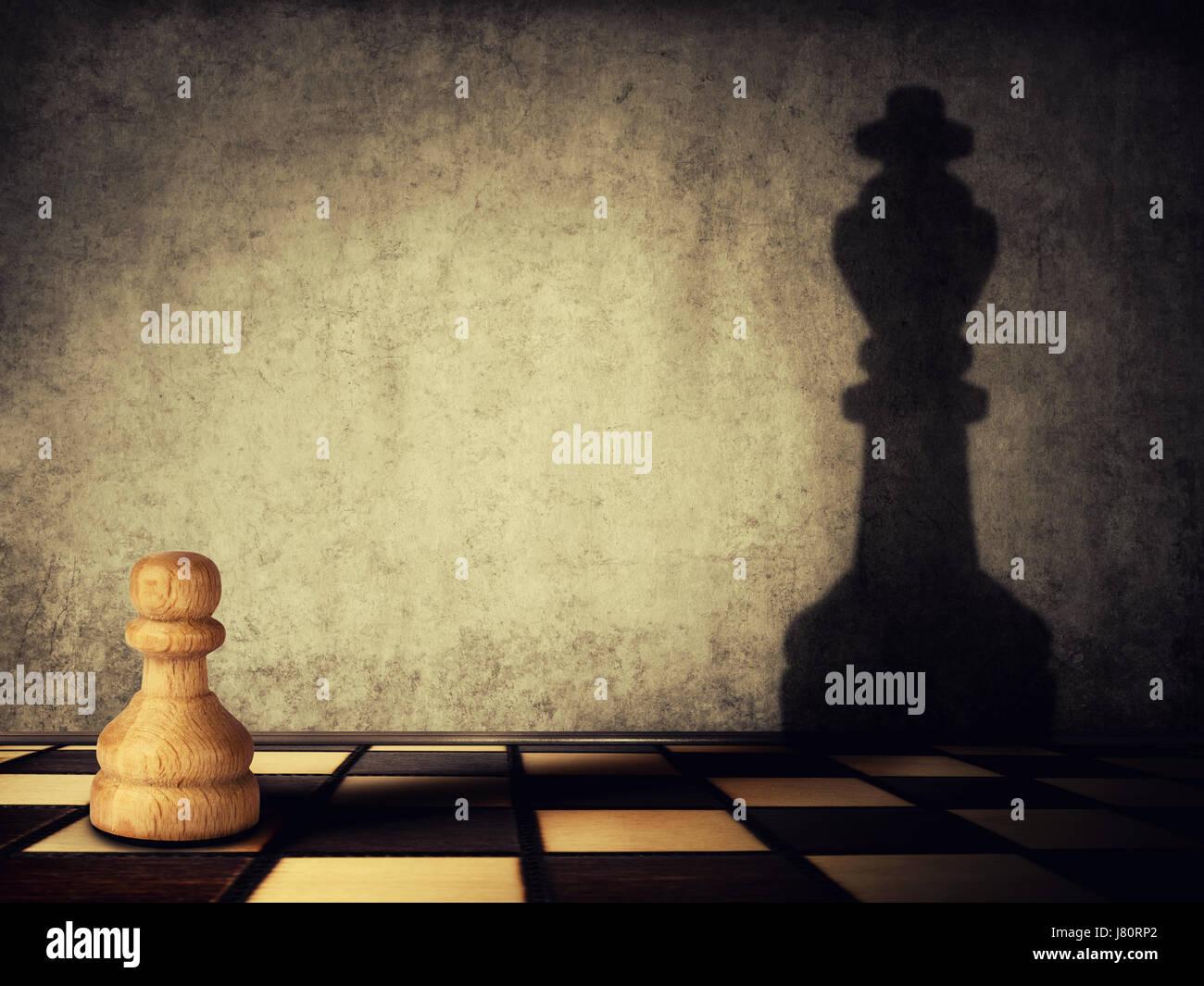 Pieza de ajedrez peón una sombra de un rey sobre un muro de hormigón. Concepto de liderazgo y las aspiraciones empresariales. Foto de stock
