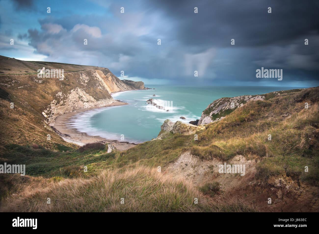 Man o' War Bay, cerca de la puerta de Durdle, y la vista hacia el este a lo largo de la Costa Jurásica, en Dorset, Inglaterra Foto de stock