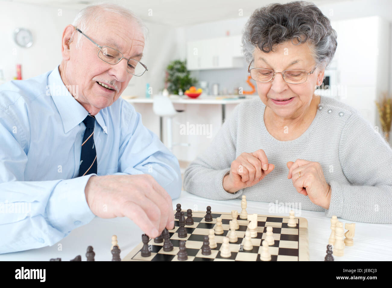 Married Couple Playing Chess At Home Imagenes De Stock Married