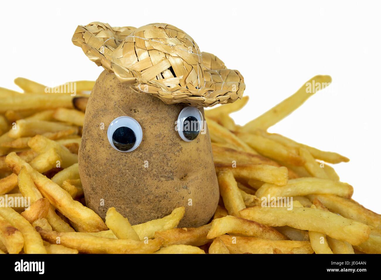 Patatas con sombrero de paja y los globos oculares en las patatas fritas Imagen De Stock