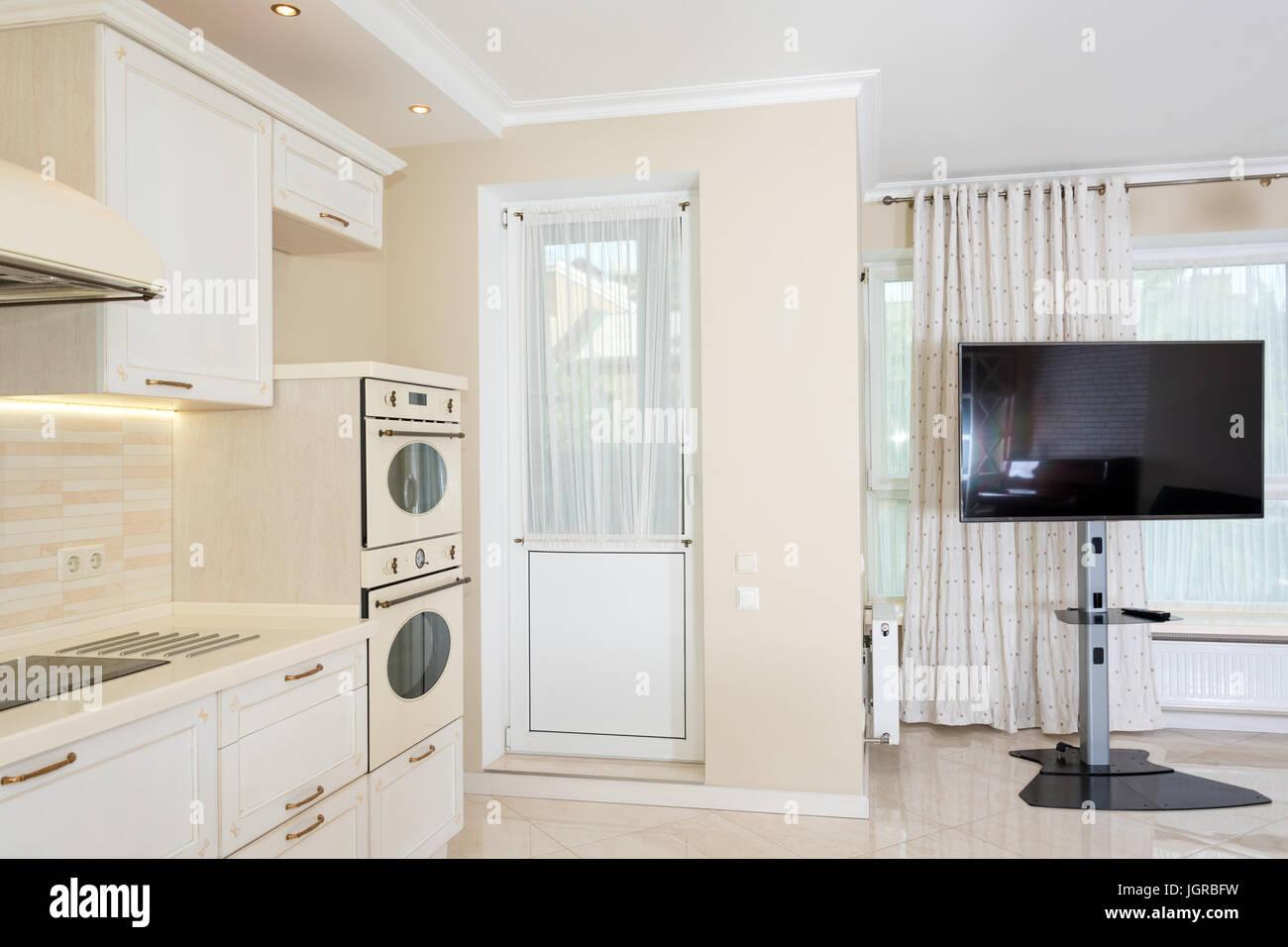 diseño clásico de sala de estar Cocina Moderna Zona Contigua A La Sala De Estar Con Un