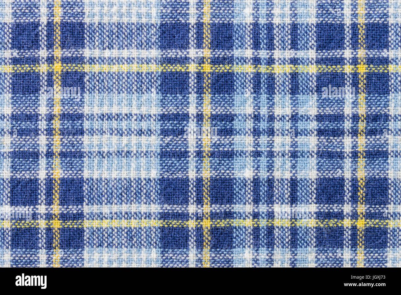 El azul y el amarillo tartan plaid o antecedentes para el diseño de moda. Tartan o patrón cuadriculado. Imagen De Stock